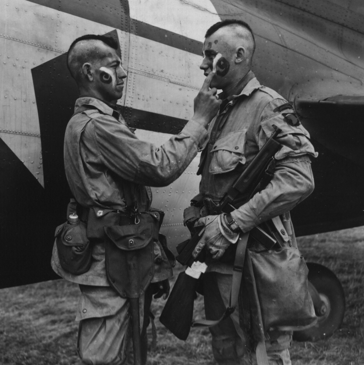 Paratrooper_applies_war_paint_111-SC-193551cropped